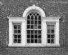 Rustic window on barn at SUNY Old Westbury Campus.