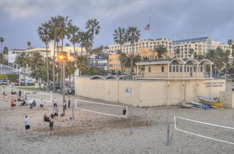 Evening volleyball at the fire & lifeguard station - the Loew's Hotel is in right background