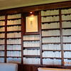 """The """"library"""" the designer took off the cover of every book and painted the binding ecru/white."""