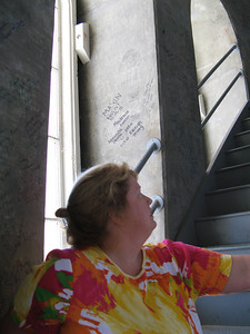 Lynne Jensen-Andres gazes up the access steps between the inner and outer domes of California's Capitol dome.