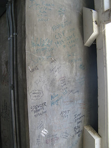 A SIGN OF TRADITION -- Visitors sign their names inside the Capitol workings.