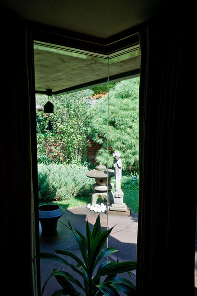 Wright was fond of unobstructed views as shown through in the glass on glass corner of the Samara House.  The view shows the green landscape keeping a sense of nature within the home.