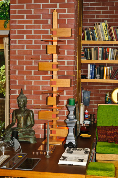 The Samara theme is apparent in the lamp against the brick wall as the fixture spirals.