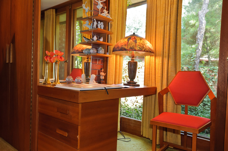 The cantalevered desk in the guest room acts as an available dresser with the drawers facing the room.  The desk chair design is modeled off a benzen ring highlighting Dr. Christian's chemistry background.