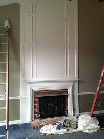 """Painting!  All trim went from """"Oyster White"""" to a bright white.  Walls are Gateway Gray from Sherwin Williams... a complex color that looks gray, taupe, or sage depending on the light.  Picked because it was going to go all over the downstairs - family room, living room, hallway, and foyer - and then up the stairs to the upstairs hallway so it needed to blend well.  Seems to go with everything but worn out, navy blue carpet.  ;)  Below the chairrail is Sage Mountain."""