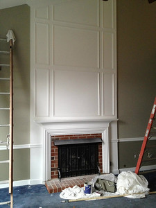 "Painting!  All trim went from ""Oyster White"" to a bright white.  Walls are Gateway Gray from Sherwin Williams... a complex color that looks gray, taupe, or sage depending on the light.  Picked because it was going to go all over the downstairs - family room, living room, hallway, and foyer - and then up the stairs to the upstairs hallway so it needed to blend well.  Seems to go with everything but worn out, navy blue carpet.  ;)  Below the chairrail is Sage Mountain."