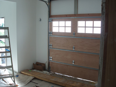 "this is the back of the garage door in the ""garden room""  It will allow us to store big items, or a great place for a wee electric car"