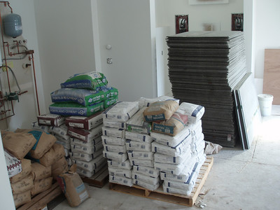 "the ""garden room"" has been turned into the staging area for the tile work that is starting on the lower floor.  If you can't sleep at night, maybe you should get a job moving some of this stuff around, your muscles will be happy to crawl in bed!"