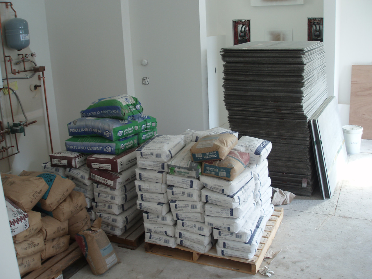 """the """"garden room"""" has been turned into the staging area for the tile work that is starting on the lower floor.  If you can't sleep at night, maybe you should get a job moving some of this stuff around, your muscles will be happy to crawl in bed!"""