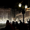 The famous water feature and and the always present visitors outside of The Bellagio Hotel, Las Vegas, NV.