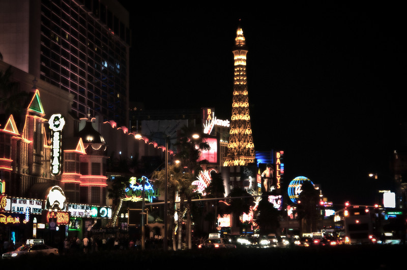 The Strip.  Paris Hotel, Eiffel Tower, neon lights and the people.