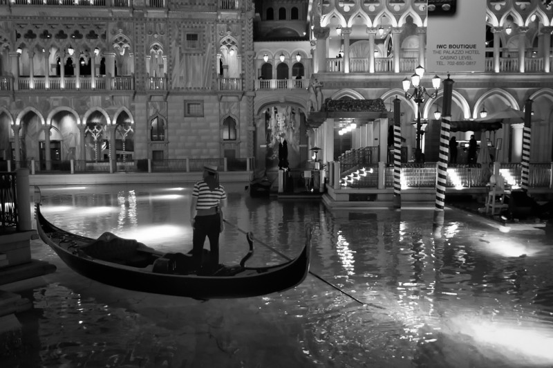 Along the front canals of the Venetian Hotel on the Vegas strip in black and white.