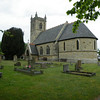 A view of the church accross the churchyard.