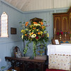 A beautiful flower arrangement alongside the altar.