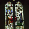 The next three stained glass windows appear to depict the early life of Jesus, and are colourful and detailed.