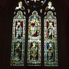 The east window shows the figure of Christ in Majesty, with St. Peter and St. Paul on either side, and St. Hugh of Lincoln,. St. Hilary and St. Gregory below.