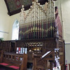 The organ is a fine example built by Nicholson of Lincoln. Records show that it cost £300.00 in 1875. It is built into an arched recess in the south wall. When built, it had 894 pipes, eight stops on the Great Organ, six on the Swell, and a Bourdon stop with octave pipes on the Pedal Organ. Over the years the pipes were reduced in number to 732. The organ was overhauled in 1983 by Henry Groves of Nottingham, but in 2007 it was fully and historically restored to its original condition by Andrew Carter of Wakefield. In this photo, the organists head can just be seen through the carved screen.