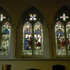 The west end stained glass windows depict the early life of Jesus, and are colourful and detailed. Here we see all three together.