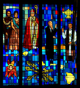 Detail of the stained glass wall in St. Andrew's Cathedral where Queen Emma, King Kamehameha IV, and their son, who died in his youth, in the lower left corner ~ also the history of the church in Hawaii is portrayed   downtown Honolulu, O'ahu, Hawai'i