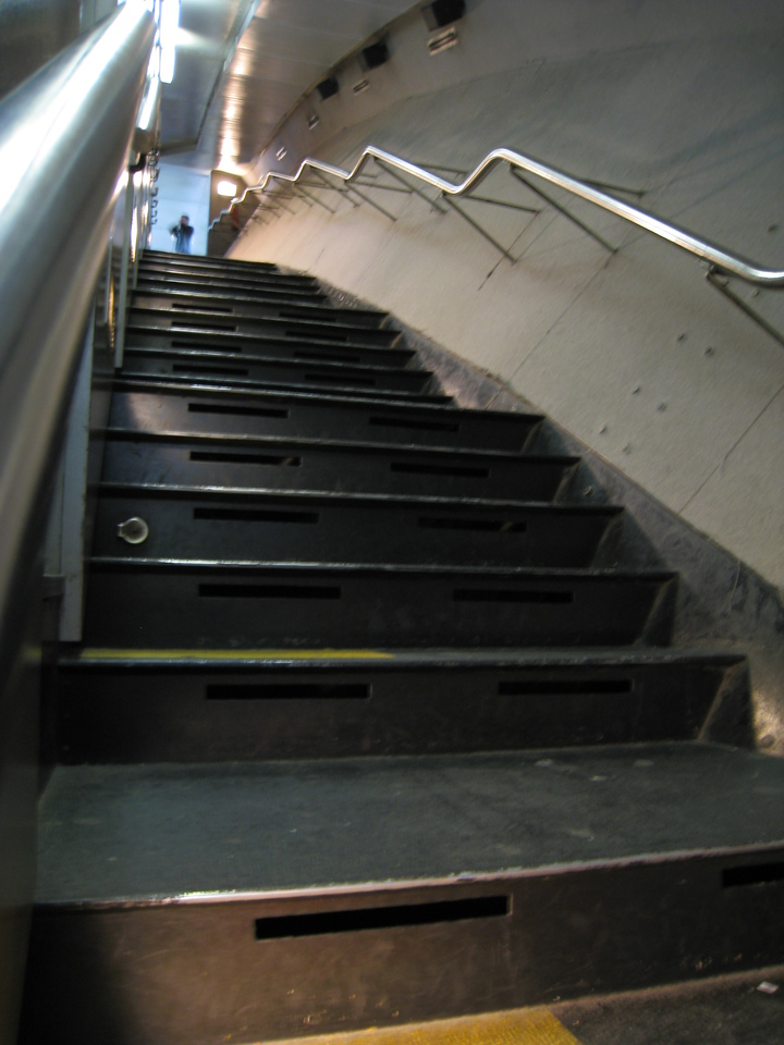 Stairs up from the tram cars to reach the peak of the arch