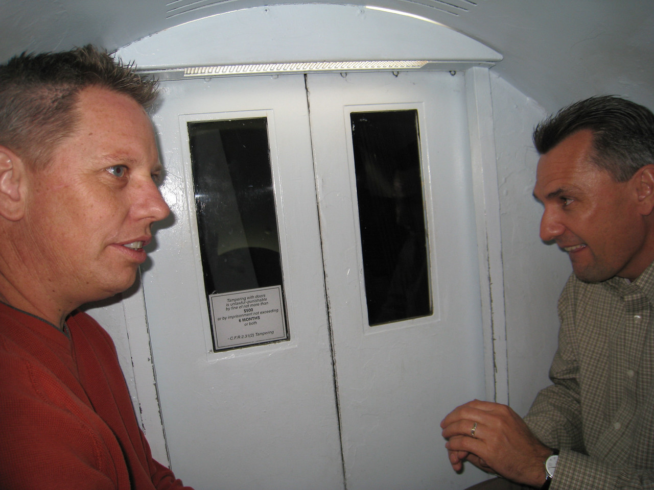 Rob Stewart and David Soeder in tram car that goes up to top of the arch