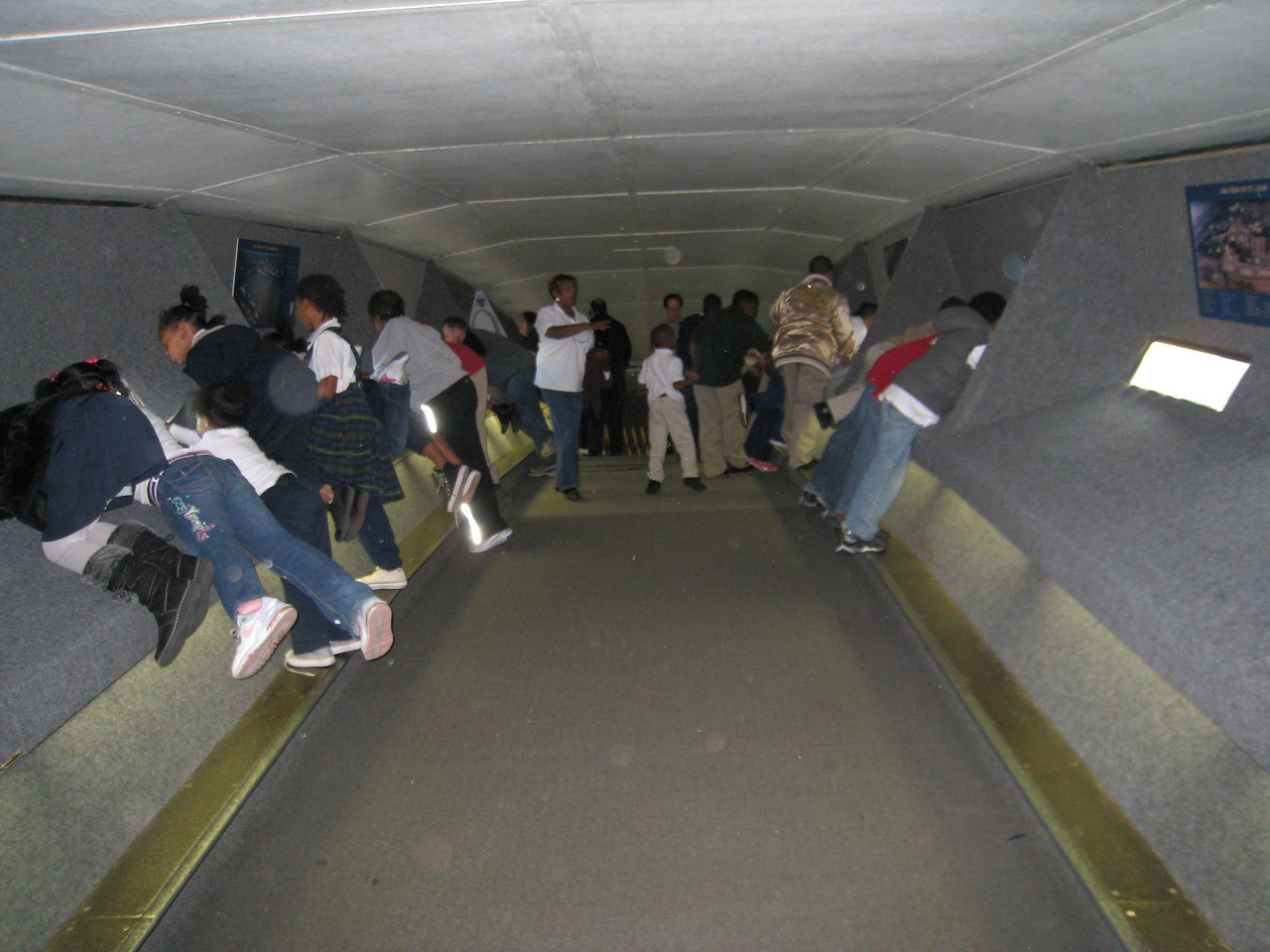People inside the top of the St. Louis arch