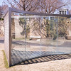 For Gordon Bunshaft, by Dan Graham, 2006, fabricated 2007-2008, two-way mirror, stainless steel, wood, and stone, in the Hirshhorn Museum and Sculpture Garden, Washington D.C.