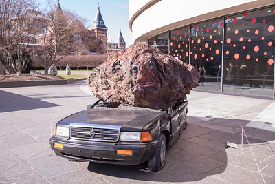 Still Life with Spirit and Xitle, by Jimmie Durham, 2007, car, volcanic stone, and acrylic paint, at the Hirshhorn Museum and Sculpture Garden, Washington, D.C.