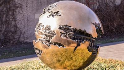 Sphere No. 6, by Arnaldo Pomodoro, 1963 to 1965, bronze, at the Hirshhorn Museum and Sculpture Garden, Washington, D.C.