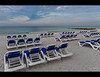 Lounge chairs on Lido Beach, Sarasota, Florida stand ready for another day.