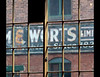 An old window in the Distillery District in Toronto.  The unfocussed panes might be originals.