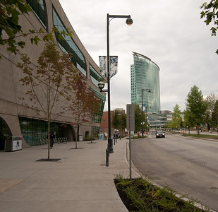 "The streetscape outside Surrey Public Library.  The ""Central City"" shopping mall and office tower, also designed by Bing Thom, is seen a block south."