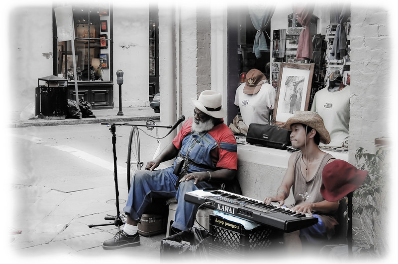 "Street musicians in the French Quarter, including the famous ""Grandpa Elliot"" in New Orleans, Louisiana."