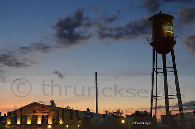 I made this photo standing in the bed of my truck looking toward the sun rising behind The Factory.