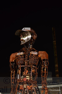 Rusty - a sculpture made of old machinery parts that stands 20' tall.  He is near one of the south entrances of The Factory.