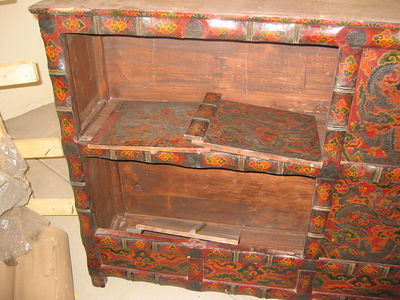 I bought this lovely Tibetan wedding chest in Udaipur, Rajastan, and had it shipped home. It arrived many weeks later, and from the appearance of the crate, you'd have thought it was totally destroyed. The front panels, however, were removable doors, and other than a few scratches and nicks, it cleaned up nicely.
