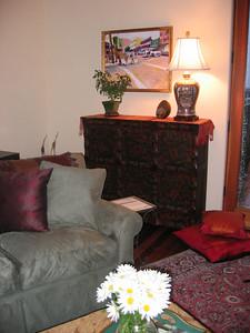 """The Tibetan wedding chest in the Living Room, beneath Tom Schwabenlander's """"Market at Sanchez."""""""