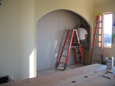 During: Drywalling the yet-to-be-built banquette (Oct 2004)