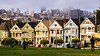 "Iconic ""Painted Ladies"" with fog covered city in the background."