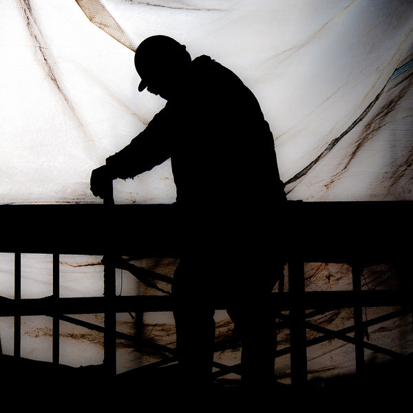 The Silhouette of a construction worker working on The Palladium - Carmel, IN