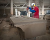 A limestone craftsman drilling anchor holes for one of the large limestone corbels for The Palladium - Carmel, IN