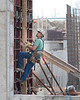 Carpenter working on concrete wall forms