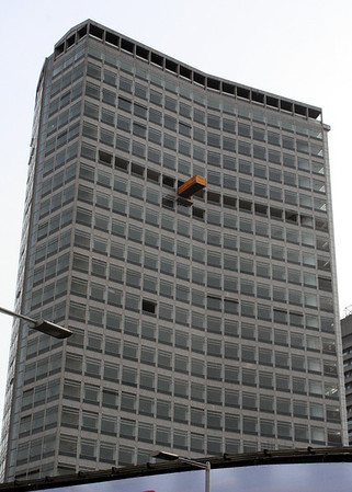 31 January 2010<br /> <br /> This skip sticking out of a window high up a tower block next to the entrance to London Bridge station, marks the first image in the gallery showing its demolition and the construction of The Shard.