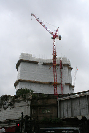 Sunday 25 April 2010<br /> <br /> Another five days down the line and this block is shrouded in plastic as it demolished.<br /> <br /> The crane in the background is the being used for the construction of The Shard.