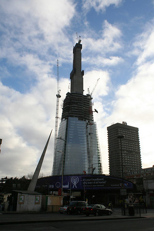 Sunday 12 December 2010<br /> <br /> The external structure of The Shard has now reached the top of the first stage of the central core. The core has now reached floor 72 and narrower top section is growing steadily and getting narrower.<br /> <br /> Since the last picture The Shard is now taller than Canary Wharf. During the last week, the BBC Radio 4 morning news programme broadcast an item from the 27th floor.<br /> <br /> The advert on the railway bridge is for BT free WiFi