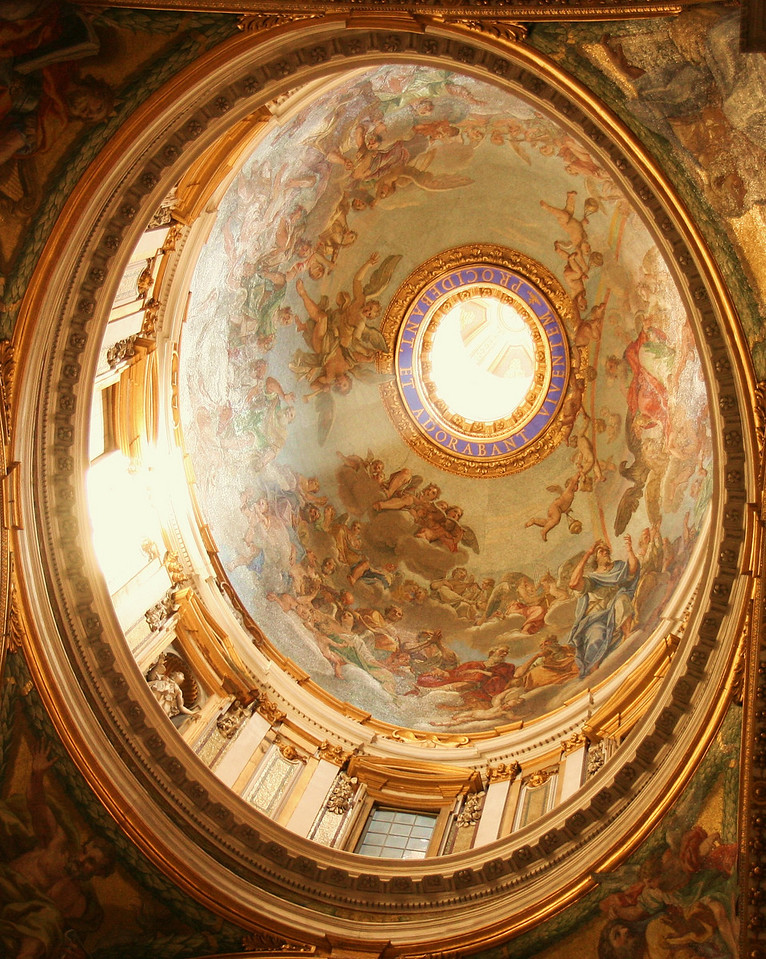 Sun shining through dome of St. Peter's Basilica, Vatican City