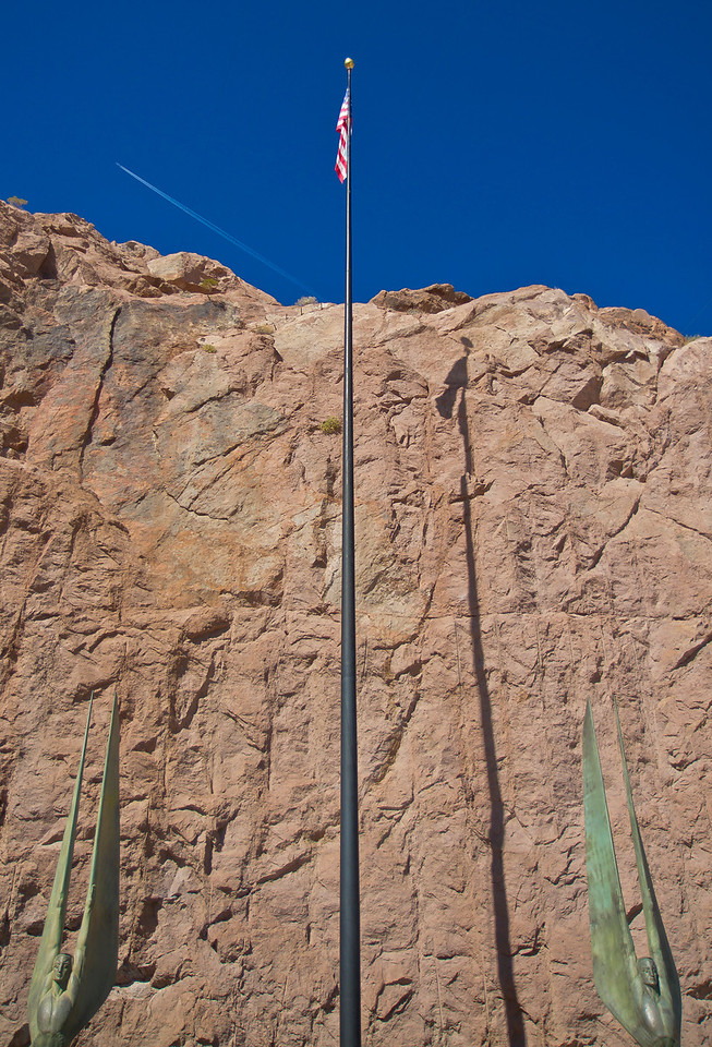 America flag and statues on the Nevada side of the Hoover Dam.  Hoover Dam, NV