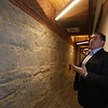 Lupoli Companies CEO Sal Lupoli gives a tour of Thorndike Exchange mixed use development. Granite walls on ground floor had been painted, and were sandblasted clean. (SUN/Julia Malakie)