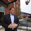 Lupoli Companies CEO Sal Lupoli gives a tour of Thorndike Exchange mixed use development. Area at right will be a dog-walking area with artificial turf, and drainage below. (SUN/Julia Malakie)