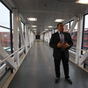 Lupoli Companies CEO Sal Lupoli stands in the walkway to Gallagher Terminal during a tour of Thorndike Exchange mixed use development. (SUN/Julia Malakie)